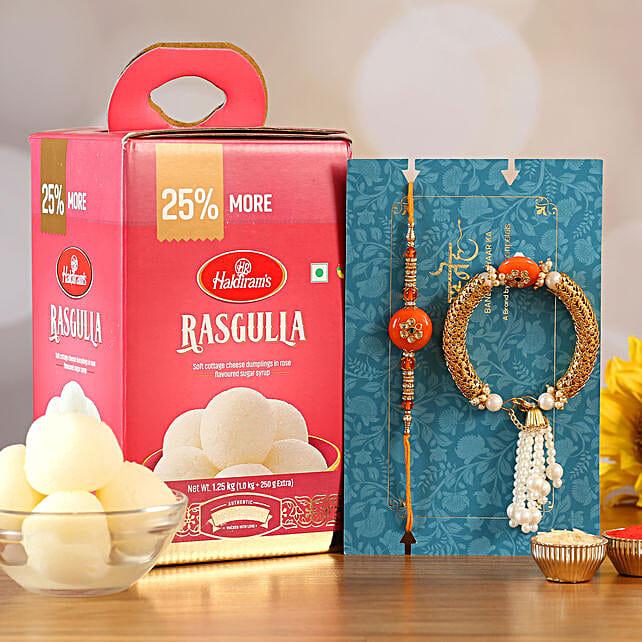 Orange Pearl Lumba Rakhi Set And Rasgulla