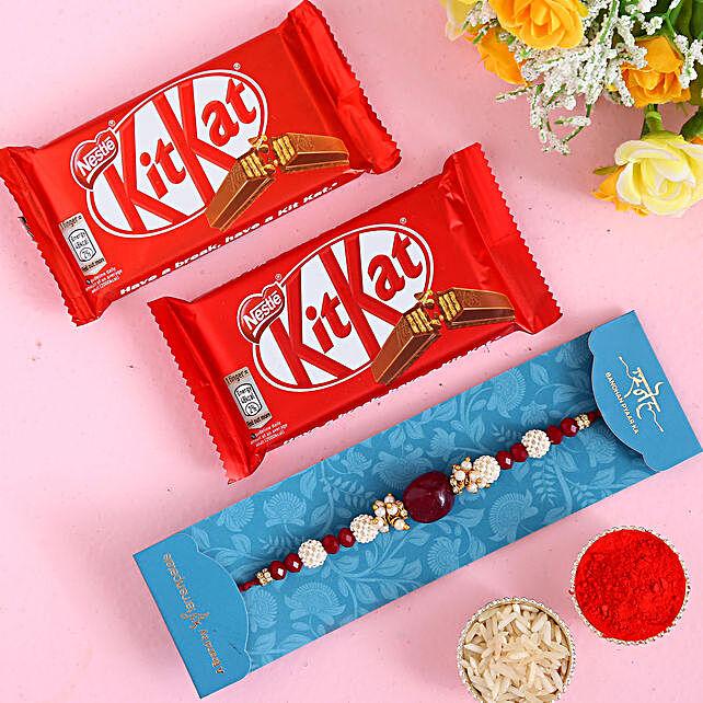 Red Beads Pearl Designer Rakhi And 2 Pcs Of Kitkat