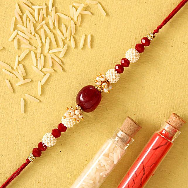 Red Beads Pearl Designer Rakhi:Pearl Rakhi to UAE