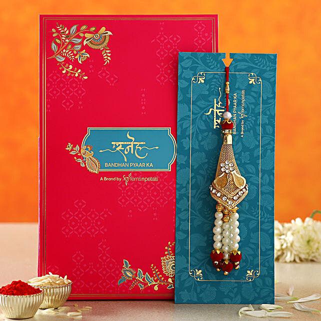 Traditional Pearl Golden Lumba Rakhi:Rakhi Sets To UAE
