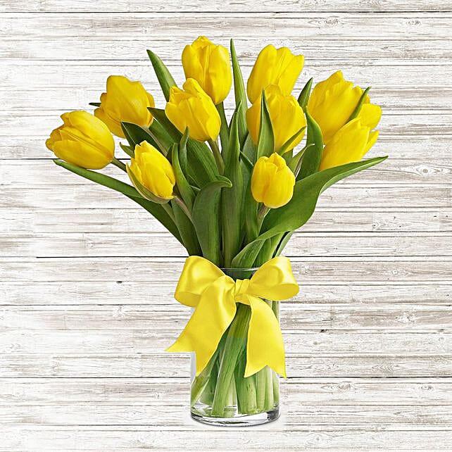 Serene Yellow Tulips Glass Vase:Send Flowers to UAE