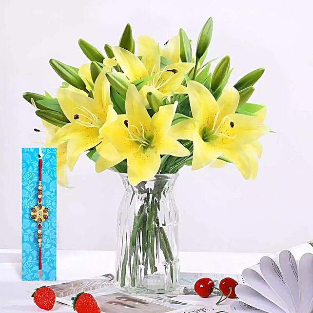Rakhi With lilies arrangement:Rakhi With Flowers to UAE