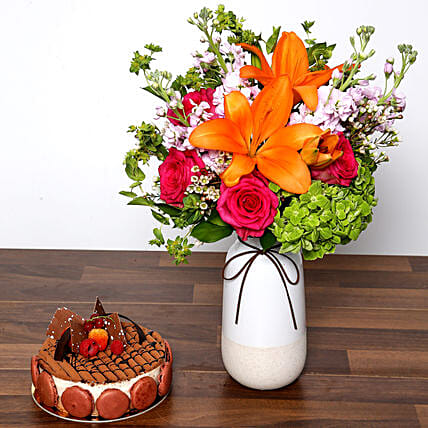 Vivid Mixed Flower Vase and Cake:Same Day Rose Delivery in UAE