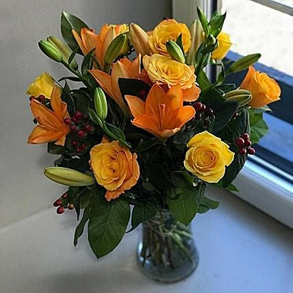 Exclusive Lilies And Roses Arrangement