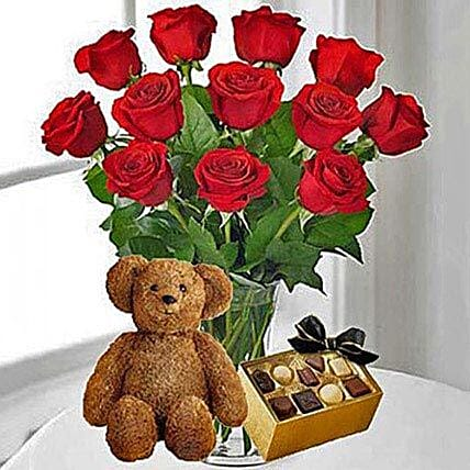 1 Dozen Red Roses, Box of Chocolates and a small Teddy Bear Birthday