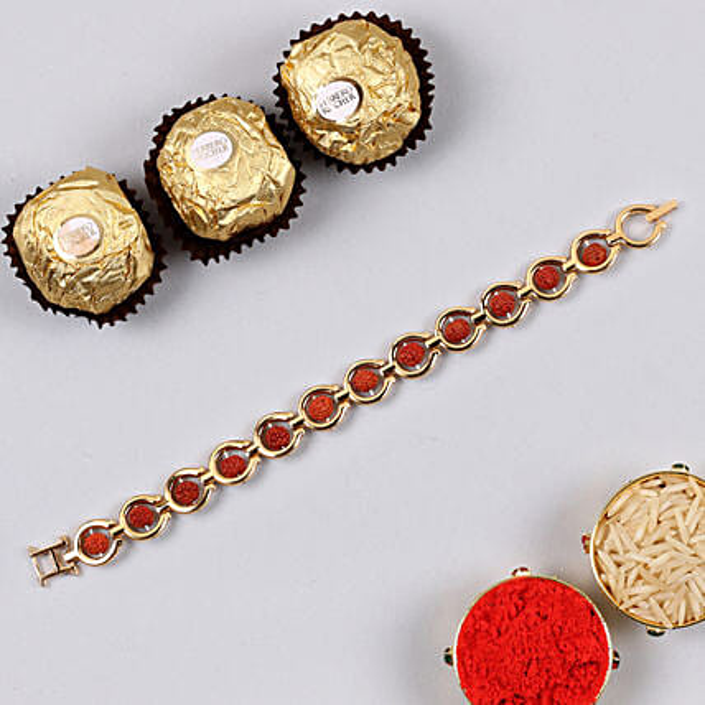 Divine Red Rudraksh Bracelet And 3 Pcs Ferrero Rocher:Rakhi to Allentown
