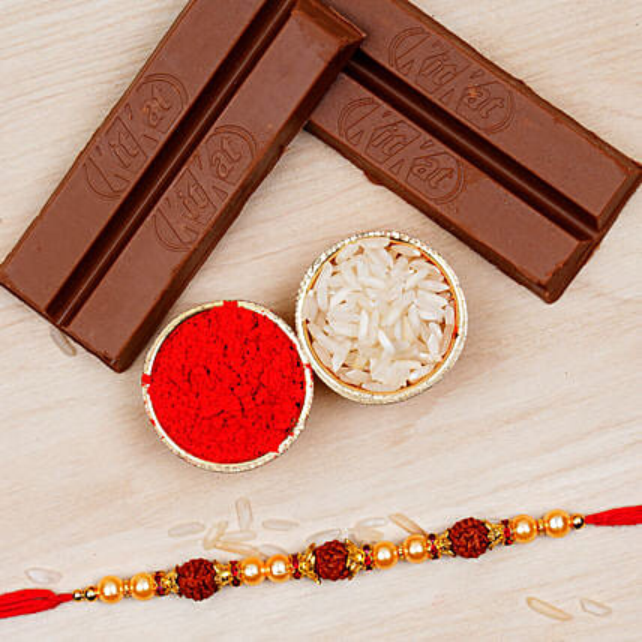 Golden Red Rudraksha Rakhi And 2 Kitkat Chocolates