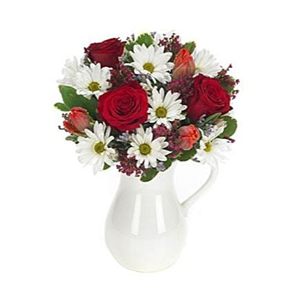 Gorgeous Floral Arrangement With White Pitcher Vase