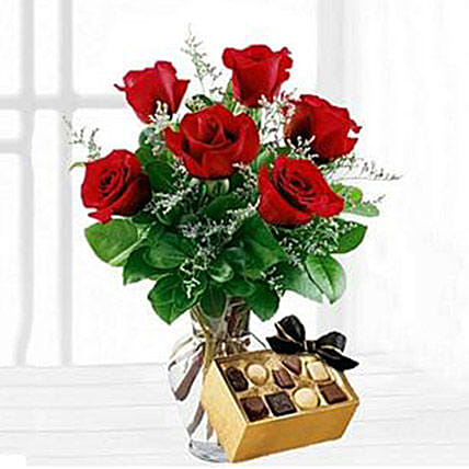 6 Red Roses, Caspia and Greens in a clear Spring Vase ...Add a box of Chocolate Birthday