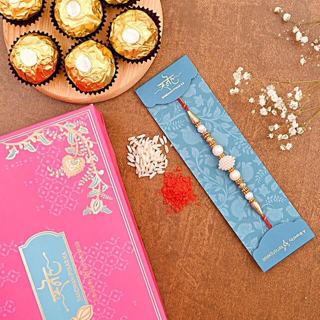 Elegant Pearl Mauli Rakhi And 3 Pcs Ferrero Rocher:Rakhi for Brother in USA