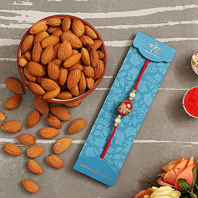 Japanese Red Stone Rakhi And Healthy Almonds:Rakhi for Sister