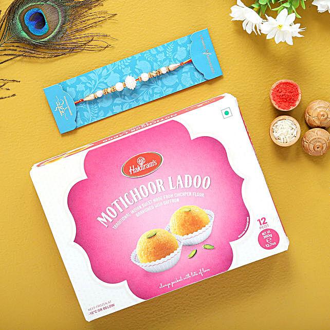 White Pearls Rakhi And Motichoor Laddoo Combo:Rakhi and Sweets to USA