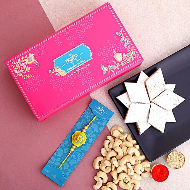 Yellow Flower Kids Rakhi And Cashew With Kaju Katli:Rakhi and Sweets to USA