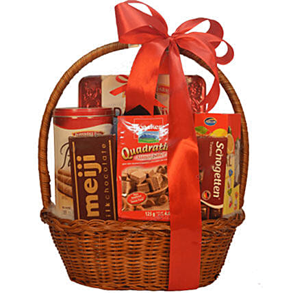 Chocolate Cookies And Cakes In Basket